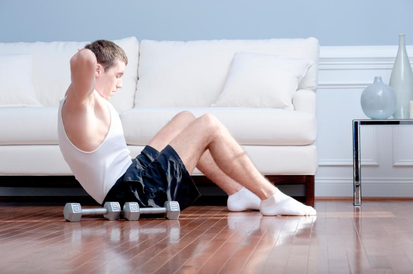 Young man doing sit-ups