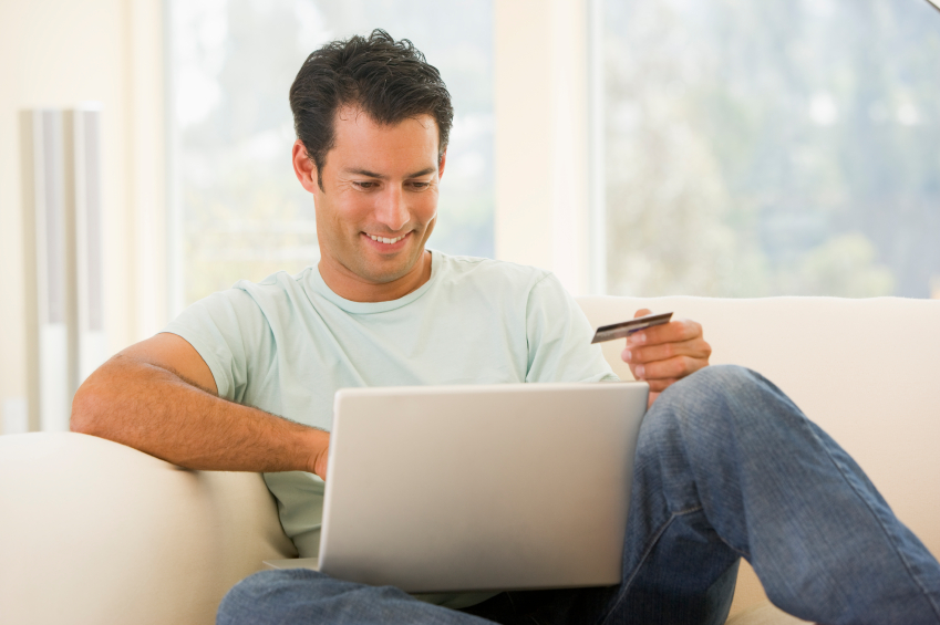 Man holding credit card for online shopping