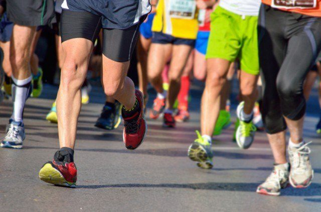 close-up of runners's feet as they compete in a race