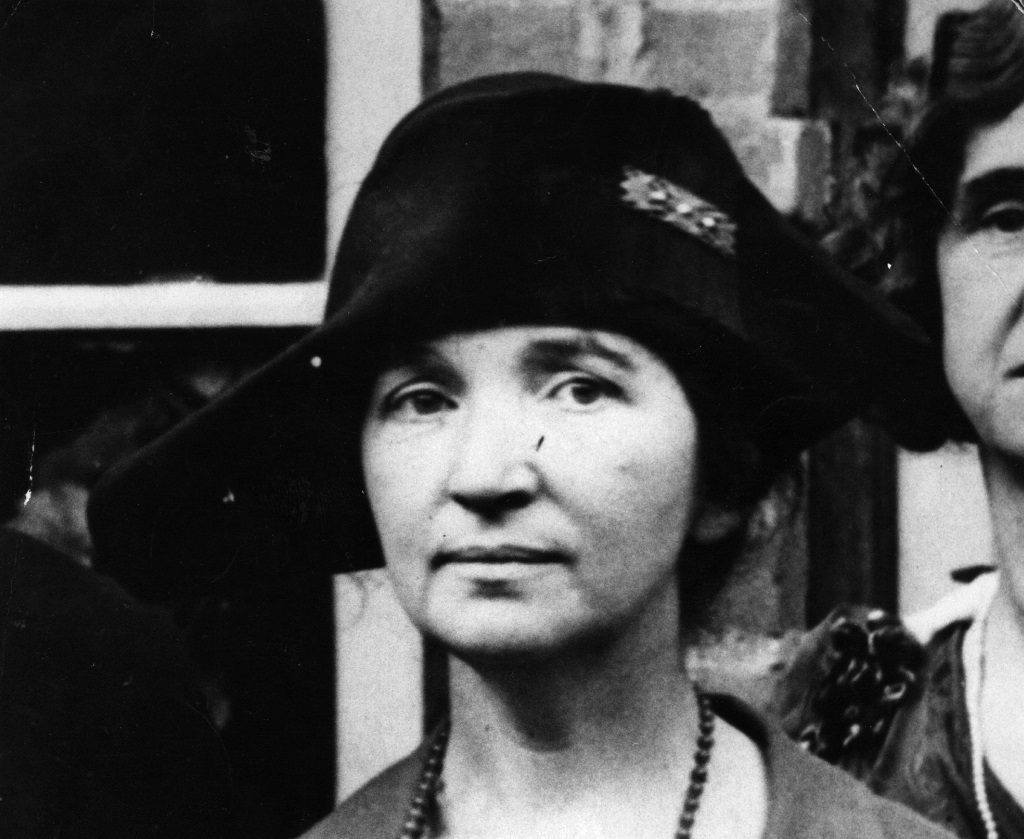 American social reformer and founder of the birth control movement Margaret Sanger wearing a hat in black and white