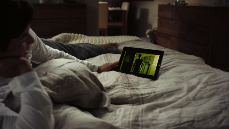 Female watches Netflix on iPad