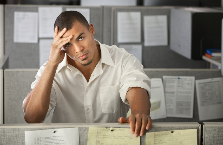 frustrated young man in office