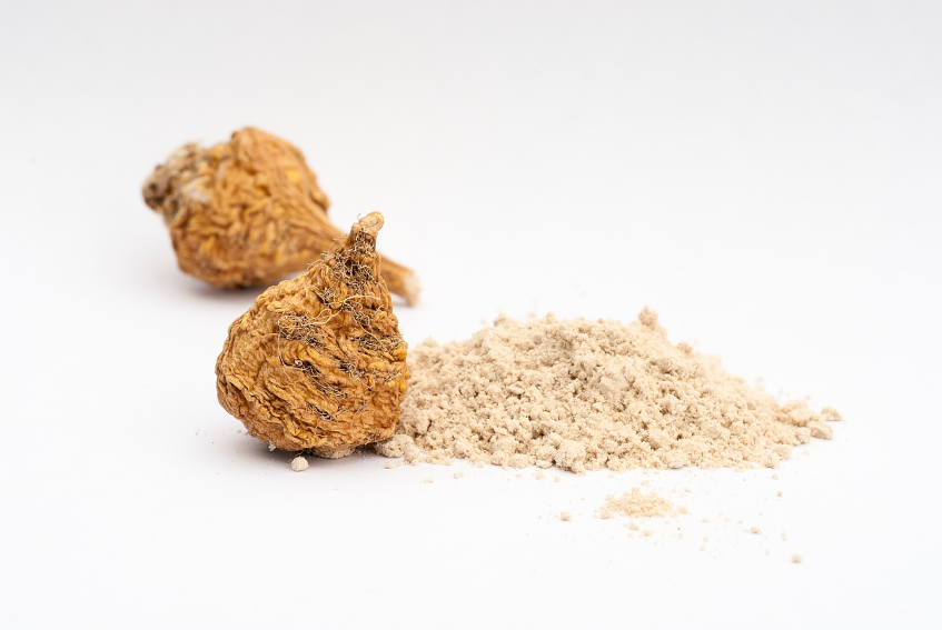 maca and its powder in a white background