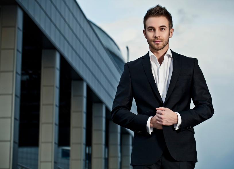 Happy businessman in a black suit