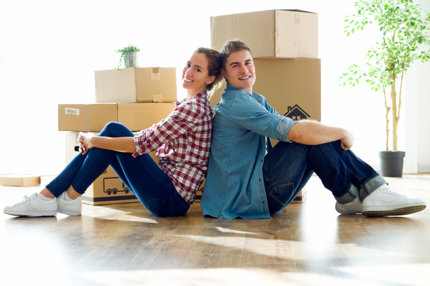 couple with moving boxes
