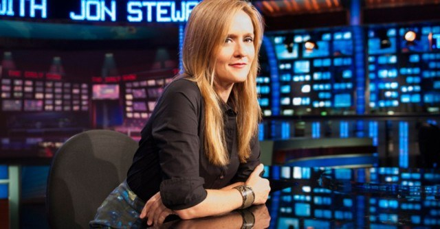Samantha Bee at a desk.