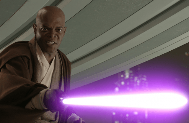 Mace Windu holding his lightsaber out in front of him.