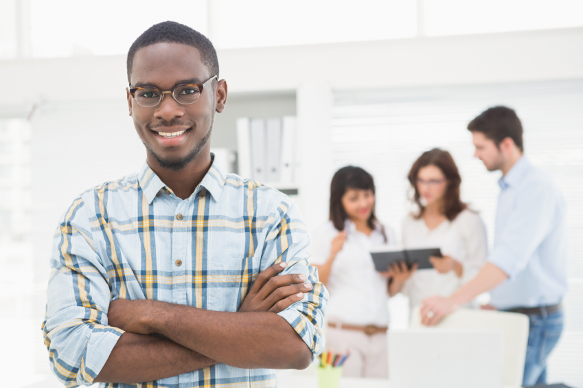 smiling young business owner in office