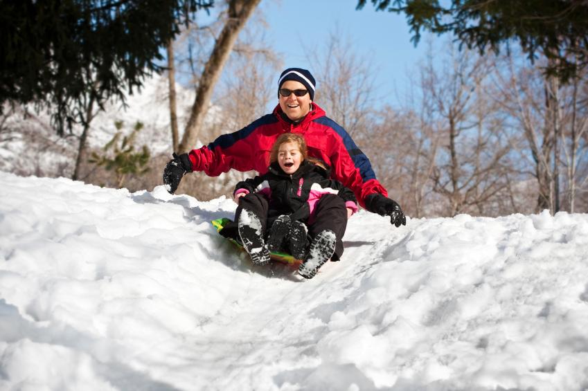 man and child sledding