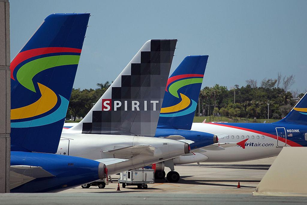 Planes sit on a tarmac