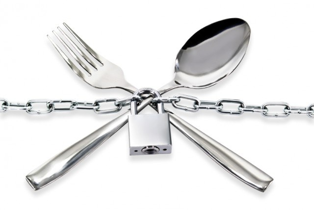 Fork and knife padlocked together