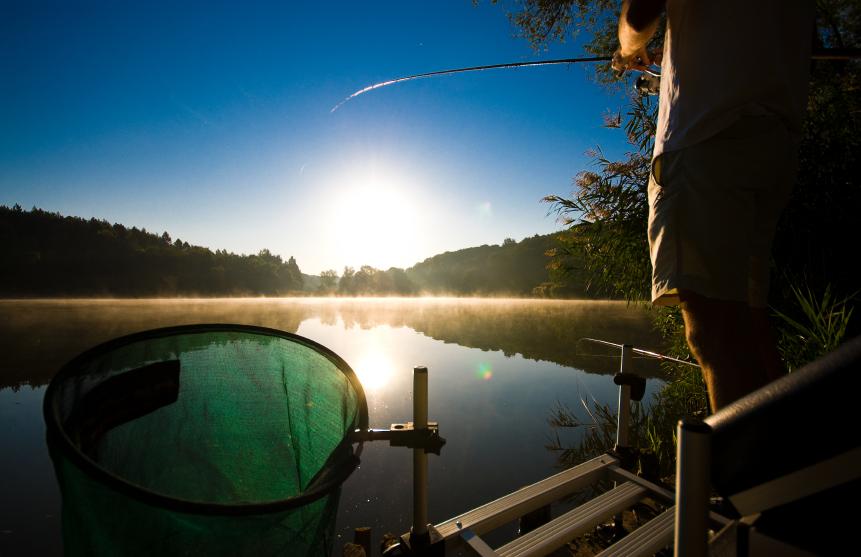 man fishing on a beautiful late