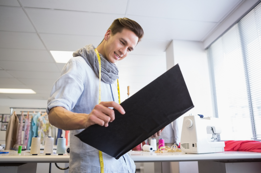 Happy student looking at notebook