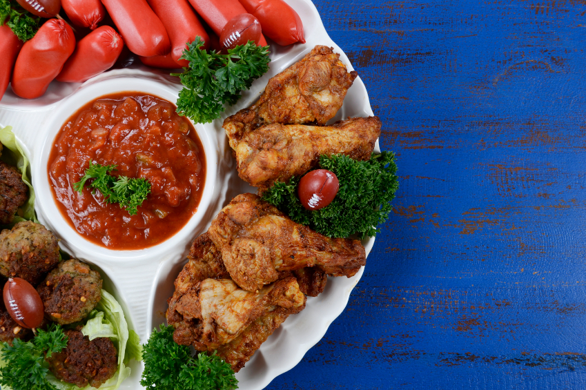 footaball party platter with wings, salsa, and cocktail winers
