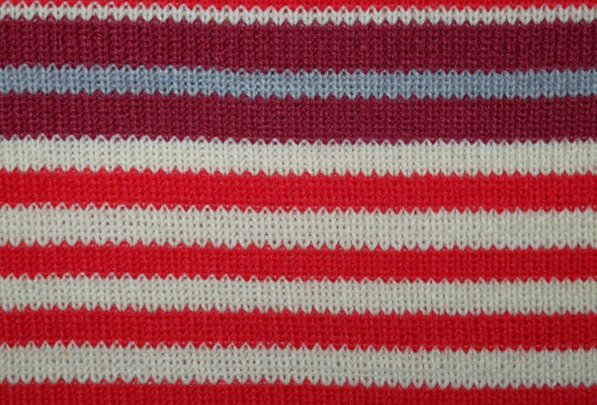 red and white colored woolen fabric