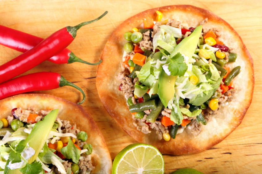 crispy tostadas or tacos with ground meat, veggies, and avocado