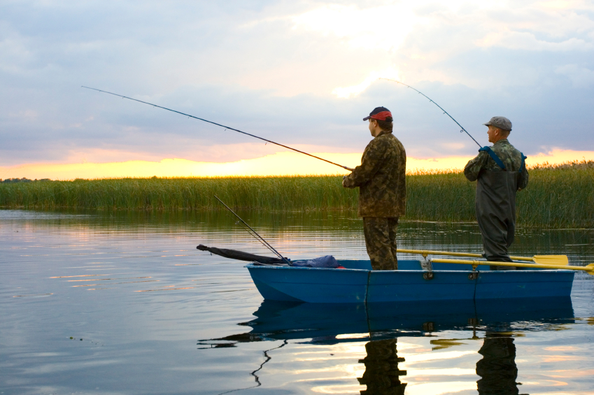 Two men fishing on a boat