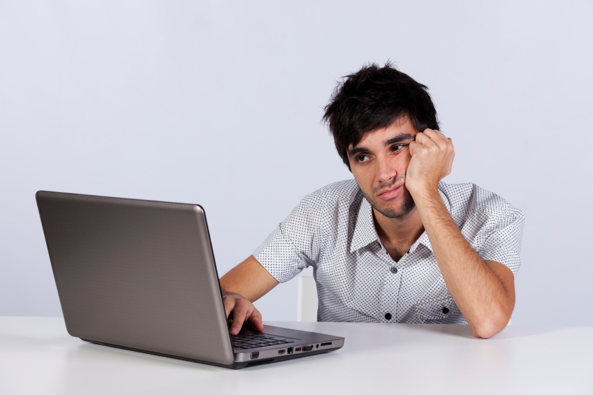 Frustrated employee sitting in front of laptop