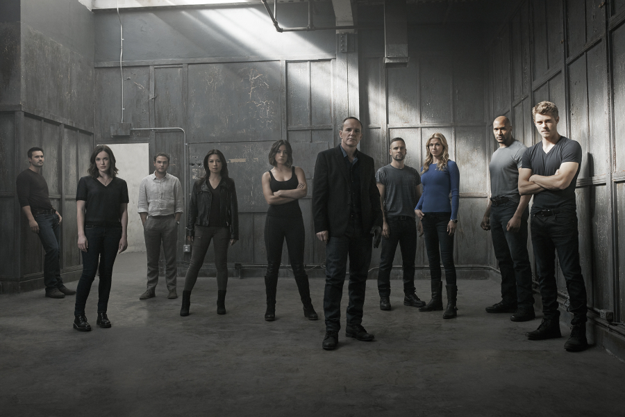 a still from the Agents of SHIELD with all the min characters standing together in a grey room