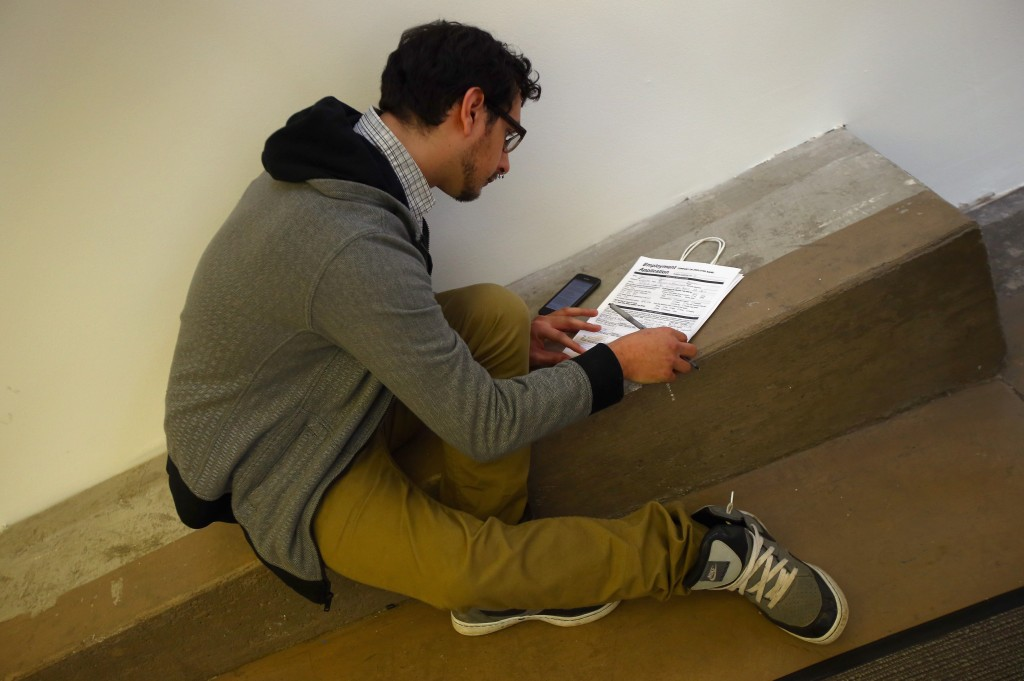 A man fills out a job application