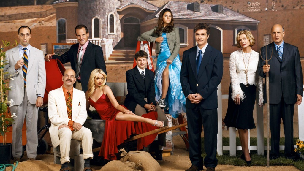 The Bluths posing in front of a home