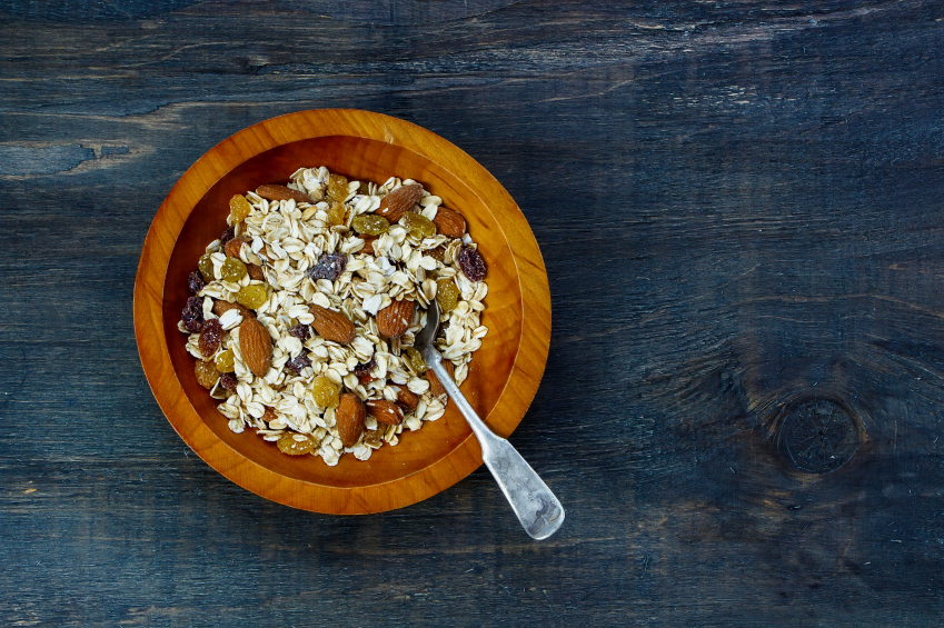 breakfast of muesli in wooden bowl