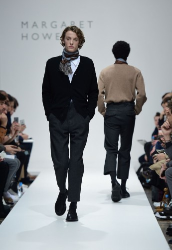 Man walking down the runway at a fashion show