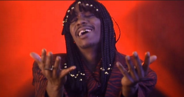 Dave Chappelle as Rick James is singing.