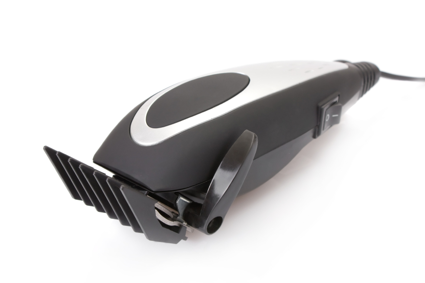 electric hair trimmer with white background
