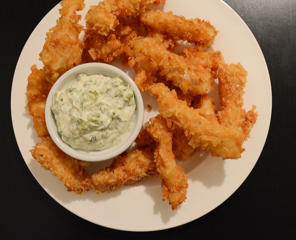 plate of potato chip crusted, beer -battered fish with dill tartar sauce