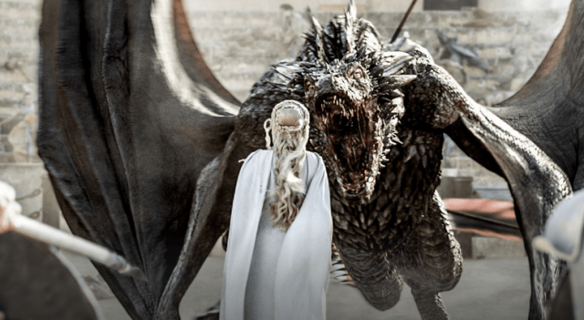 Dragons stare down Daenerys Targaryen in a scene from HBO's Game of Thrones