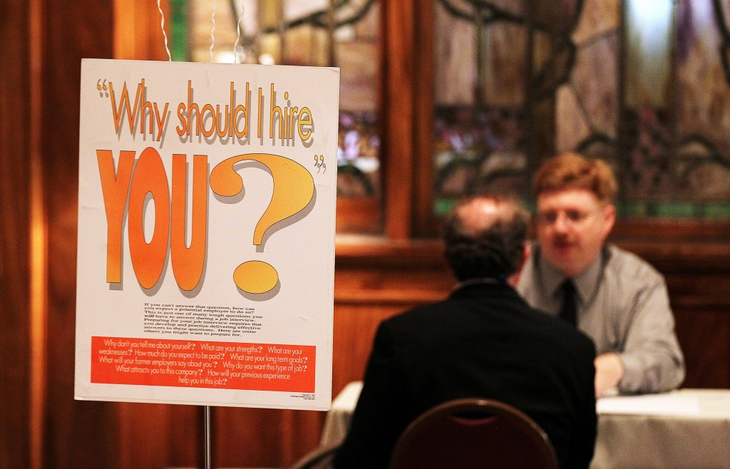 candidate discusses his job skills at a hiring fair