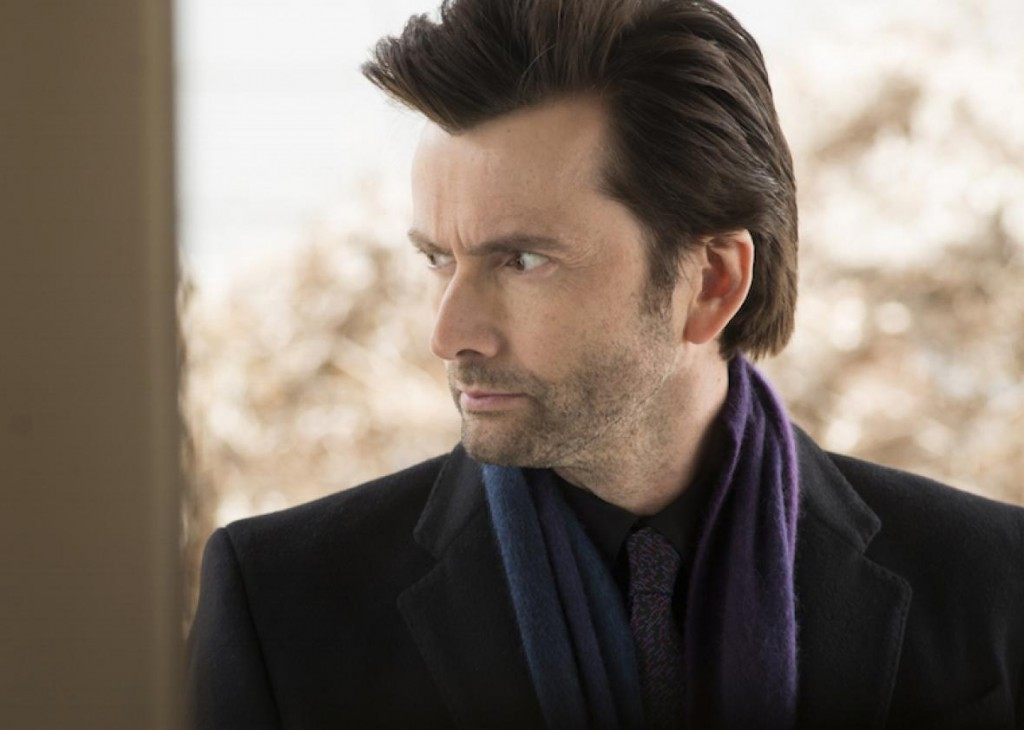 David Tennant as Killgrave, wearing a purple scarf and looking to his right