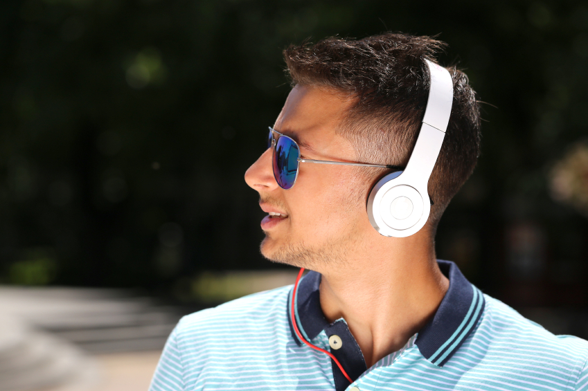 young man listening to music with headphones