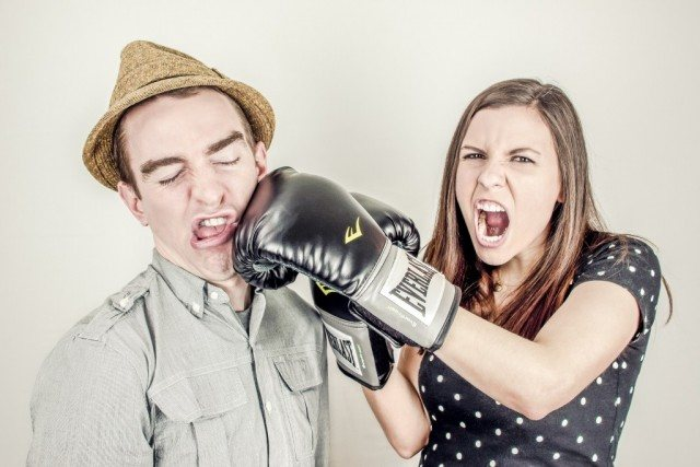 a couple fighting with boxing gloves
