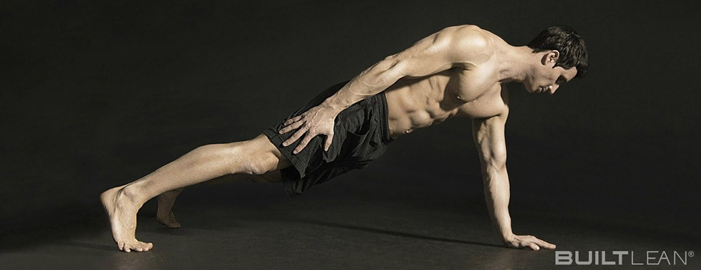 shot of Marc Perry doing one-arm push-ups on a black background