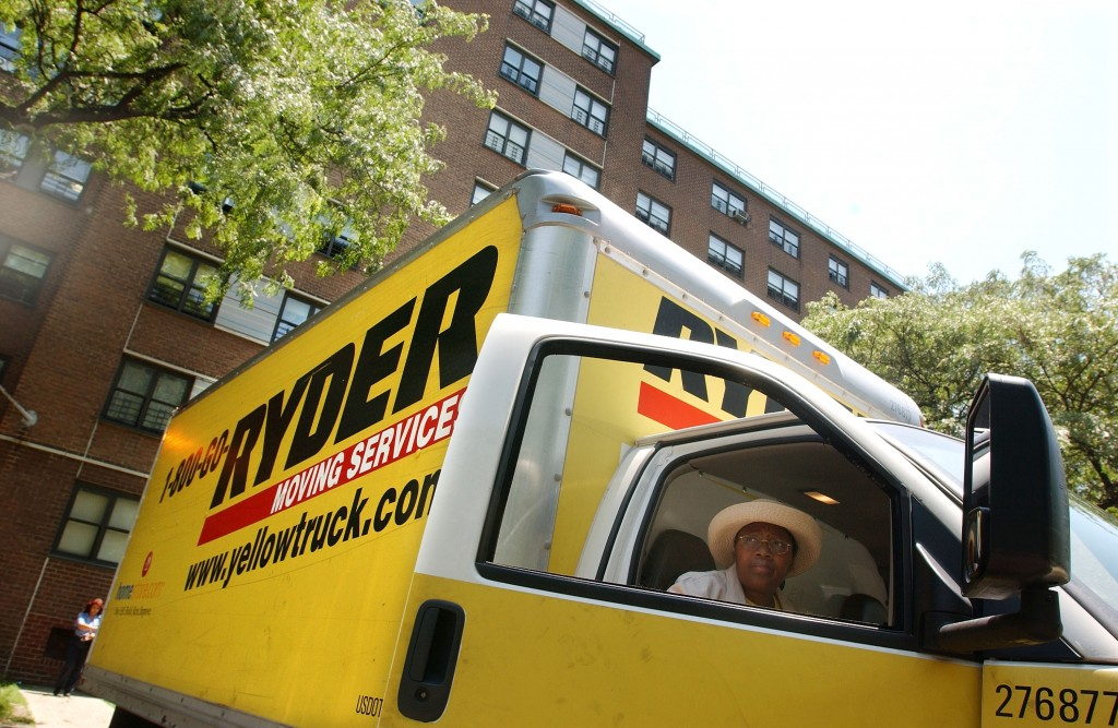 A moving van outside of an apartment building