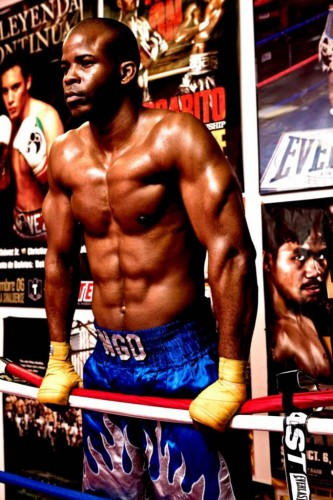 Ngo Okafor grasping sides of boxing ring