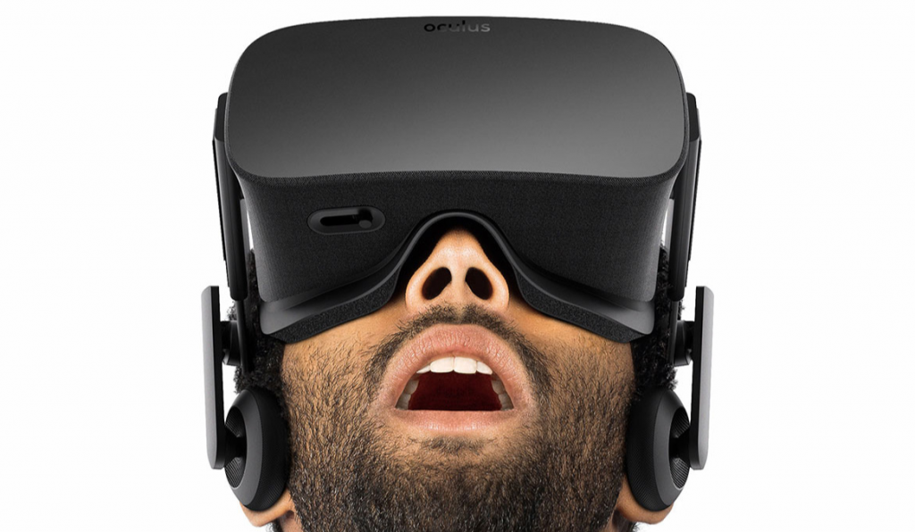 A man stares in awe as he wears a VR headset.