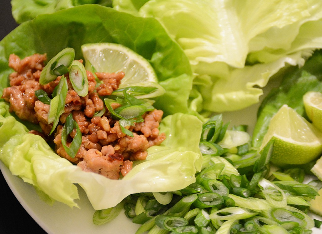 soy-ginger pork lettuce wraps with scallions and lime