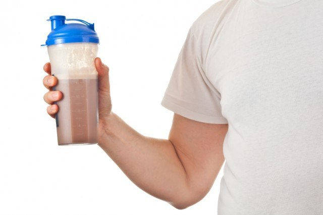 Man holding a protein shake