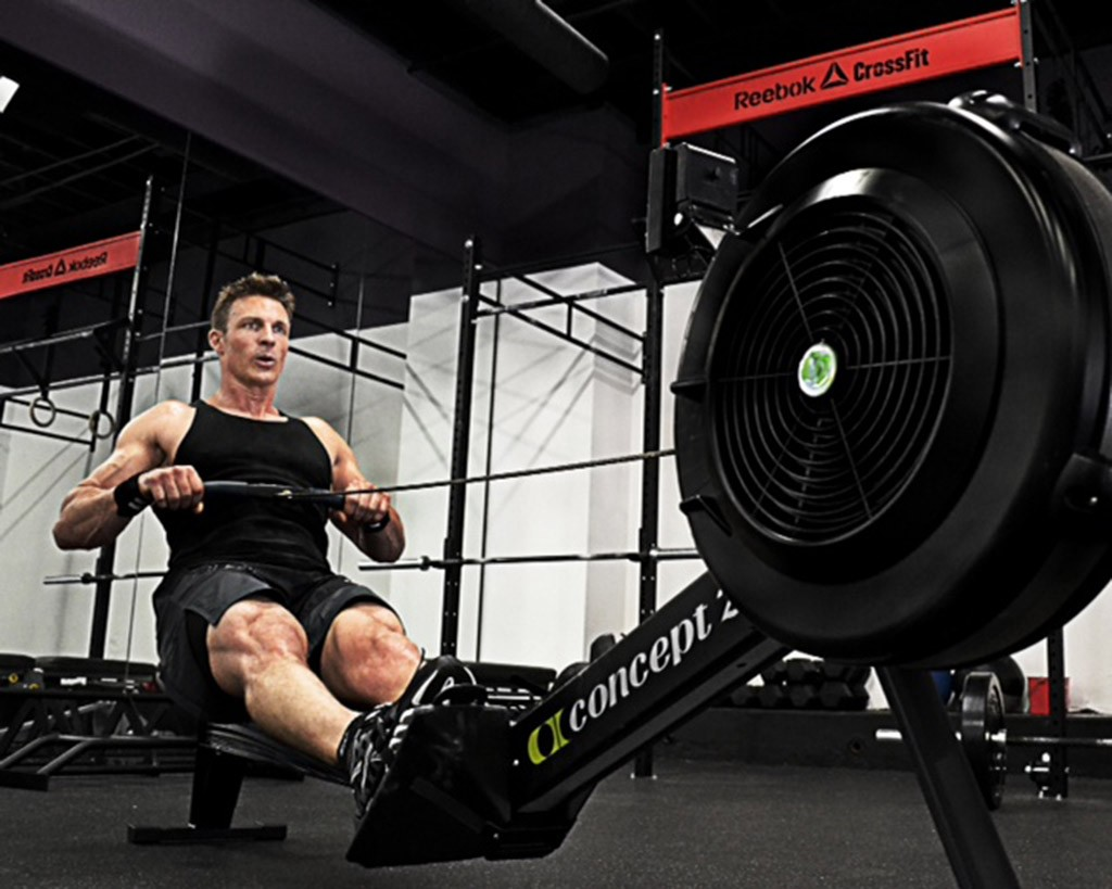 Personal trainer Ron Mathews working out on a row machine