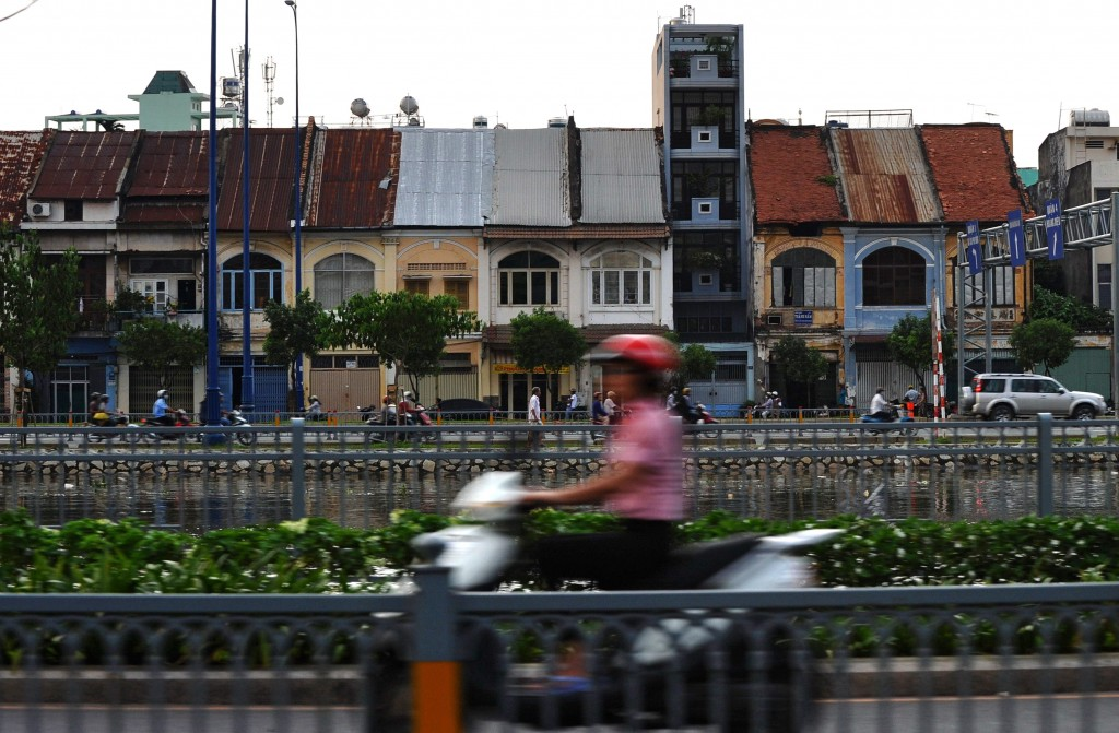 woman on scooter in saigon