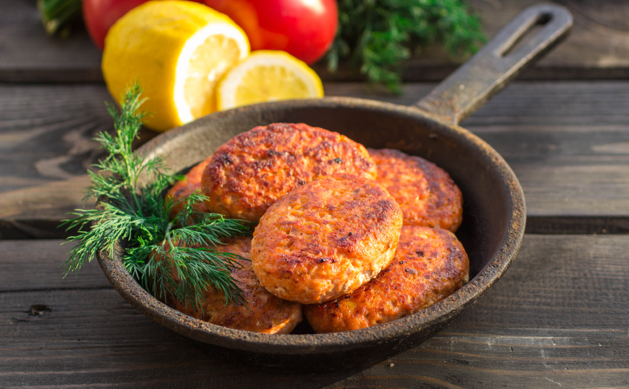 salmon fishcakes in an iron pan