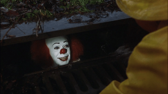 Tim Curry as Pennywise in Stephen King's IT