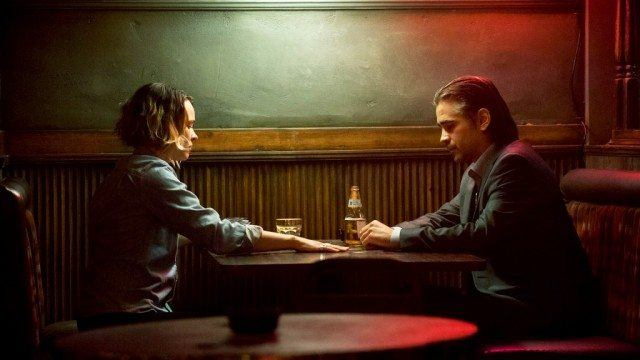 Ani and Ray sit opposite one another in a bar booth in a scene from Season 2 of 'True Detective.'