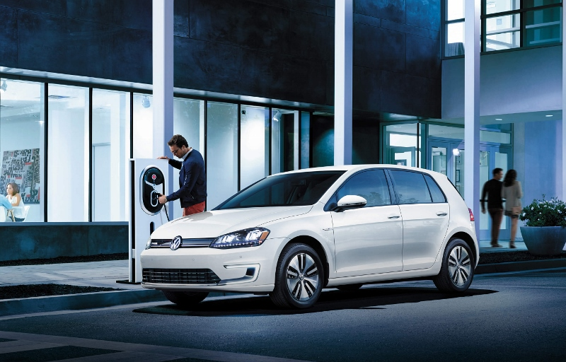 The Volkswagen e-Golf charges up at a station.