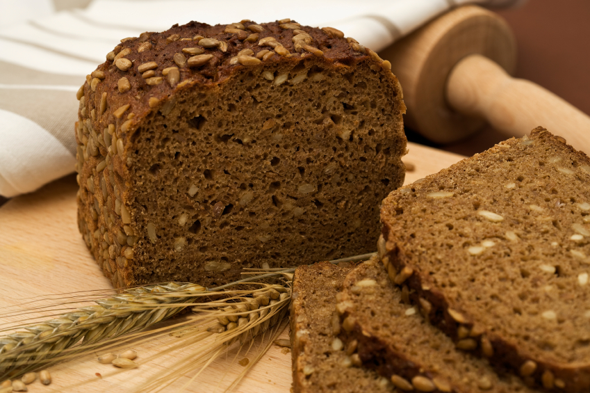 whole-grain bread slices with blades of wheat
