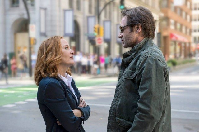 Scully and Mulder stand across from each other