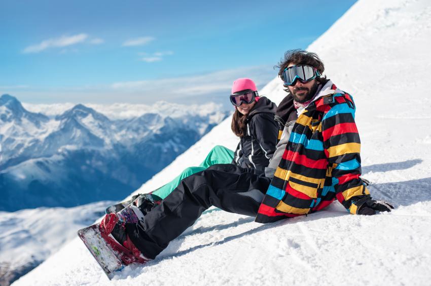couple enjoying on snowy mountain